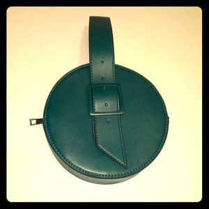 A new day GREEN PVC VEGAN LEATHER ROUND CLUTCH